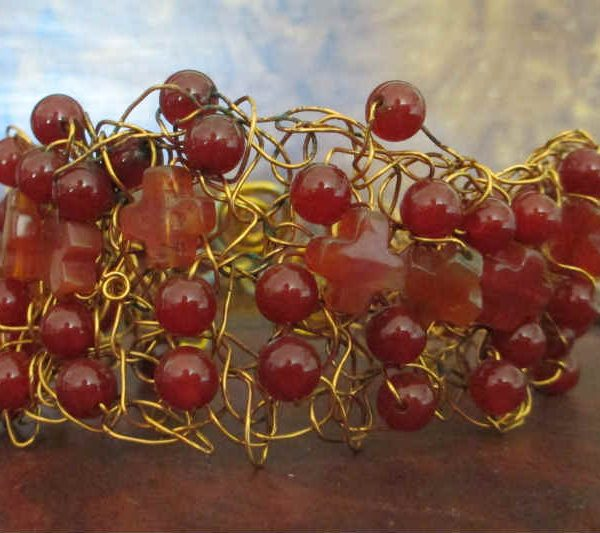 wire crocheted bracelet with carnelian beads and crosses