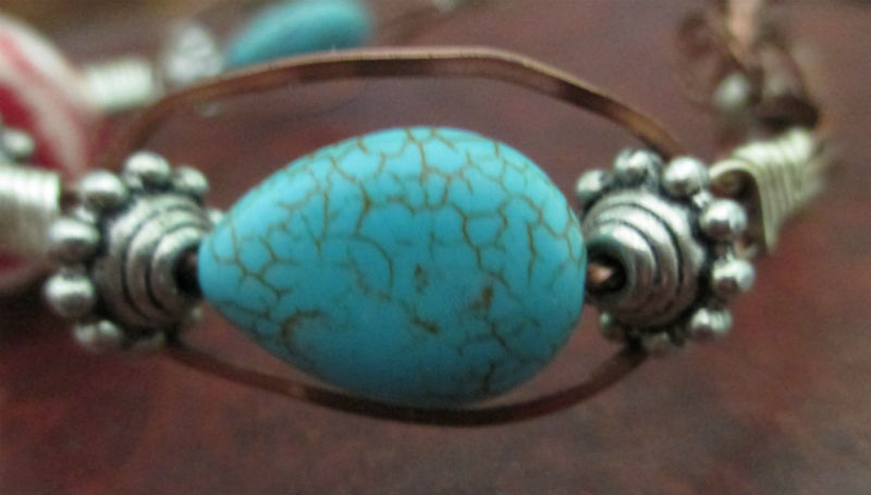 side view of light coral three wire bracelet