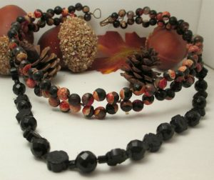 marigold bead and twist choker with all black drop.