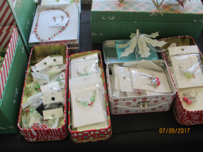 decorative tins with holiday earrings and bracelets