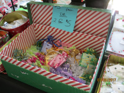 decorative box filled with holiday earrings in small organza bags